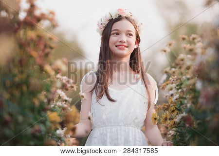 Portrait Of  Girl In A Flower Wreath,lovely Girl In Spring Flowers ,the Face Of A Smiling Girl Or A