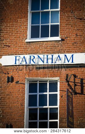 Farnham Hand Painted Sign On Typical Georgian Building In Surrey