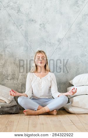 Morning Meditation. Lifestyle Concept. Young Woman Sitting On Floor Cross Legged With Mudra Hands. C