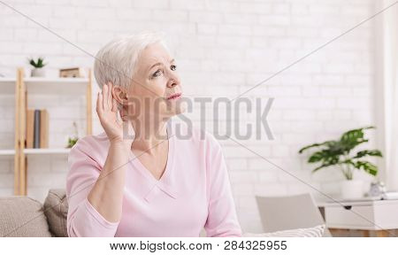 Age-related Hearing Loss, Symptoms. Senior Woman Listening For Something At Home, Panorama With Free