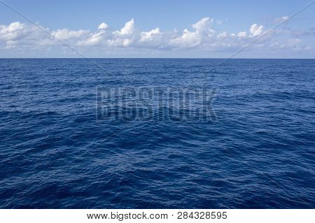 Blue Sea And Sky With Clouds For Background Or Wallpaper