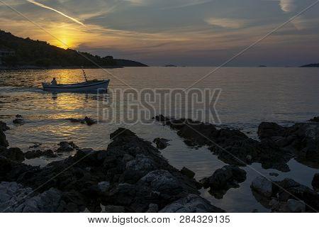 Fishing Boat And Romantic Sunset On The Adriatic Bay In Croatia Near Rogoznica