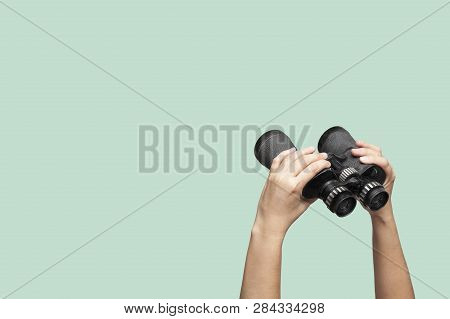 Hands Holding Binoculars On Green Background, Looking Through Binoculars, Journey, Find And Search C