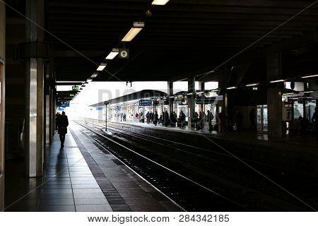 Mainz, Germany - November 25: Silhouettes Of Travelers At A Platform Of Mainz Main Station On Novemb