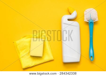 Disinfection concept. Basic cleanup set. Copy space on yellow background. poster