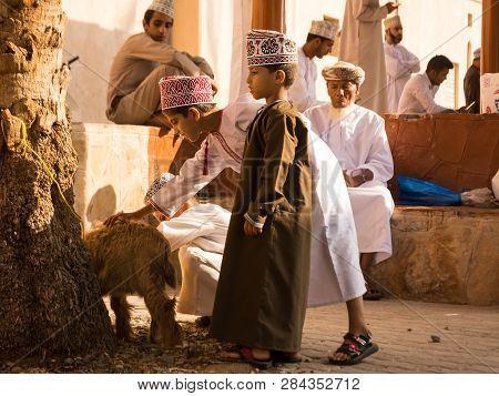 Nizwa, Oman - November 2, 2018: Omani Children Play With Animals At The Nizwa Friday Market