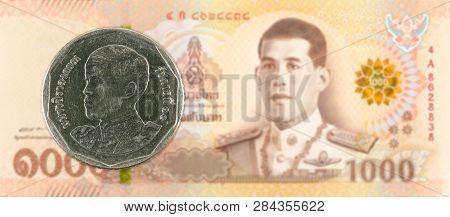 5 New Thai Baht Coin Against 1000 New Thai Baht Banknote