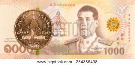 50 Thai Satang Coin Against 1000 New Thai Baht Banknote