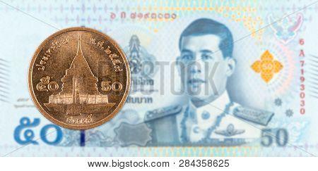 50 Thai Satang Coin Against 50 New Thai Baht Banknote