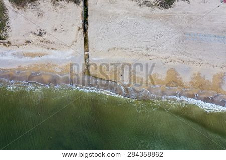 Discharge of dirty industrial wastewater in sea on city beach. Poisoning of recreation areas by spread of diseases, destruction of flora and fauna as result of violation of the ecology of sea coast poster
