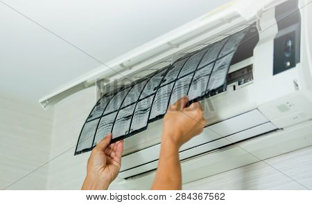 Selective Focus To Left Hand Of Male Technician Cleaning Air Conditioner Indoors With A Lot Of Dust