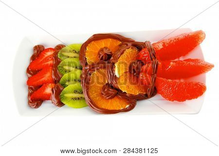 exotic fruits in cream on white plate