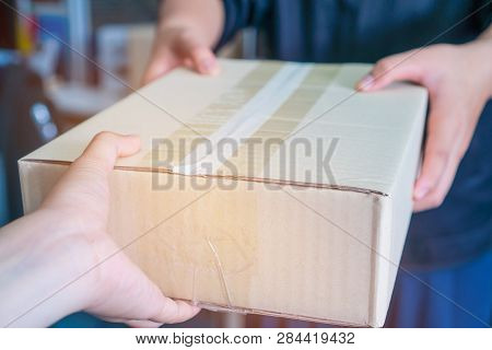 Deliveryman Get Parcel Box Package To Asian Customer Accepting Delivery Of Boxes Packages From Deliv