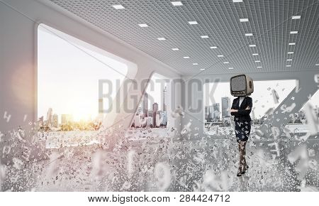 Business Woman In Suit With An Old Tv Instead Of Head Keeping Arms Crossed While Standing Among Flyi