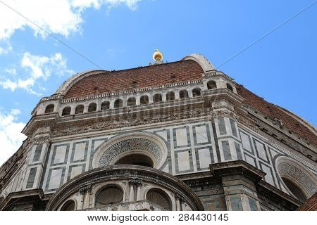 Architectural Detail Of The Dome Designed By Architect Brunelleschi And The Big Golden Sphere On The