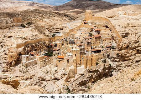 Holy Lavra of Saint Sabbas, Mar Saba, Eastern Orthodox Christian monastery overlooking the Kidron Valley halfway the Old City of Jerusalem and the Dead Sea. West Bank, Palestine, Israel. poster