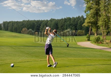 Boy Playing Golf, Makigng Shot From The Tee