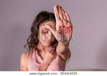 Domestic Violence, Protesting And People Concept - Brunette Woman Expressing Denial With No On Her H