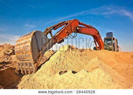 Excavator at sand quarry
