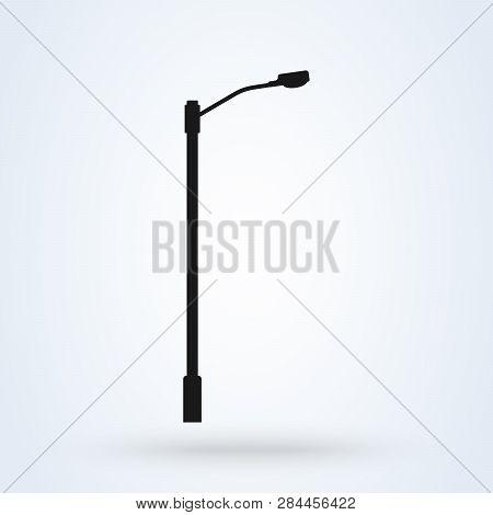 Street Light Vector Icon. Lamppost Flat Silhouette.