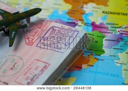 A passport and world map