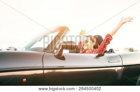 Young Laughing Female Cheerful Rising Hands Up In By Cabriolet Car In Sunny Day Time