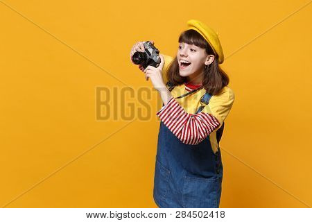 Joyful Girl Teenager In French Beret, Denim Sundress Taking Pictures On Retro Vintage Photo Camera I