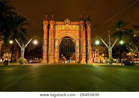 The Arc de Triomf, archway structure in Barcelona, Spain, at night. It was built for the Exposiciуn Universal de Barcelona (1888). poster
