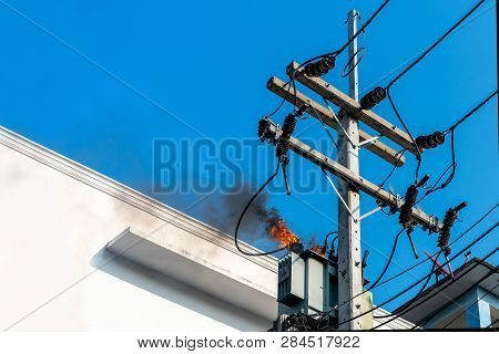 Power Pylon Overload Or Electric Short Circuit At Transformer On Poles And Fire Or Flame With Smoke