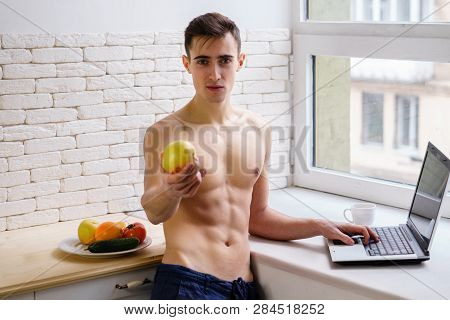 proper nutrition, healthy lifestyle, motivation, fitness. young fit sporty man blogger offering an apple for light snack poster