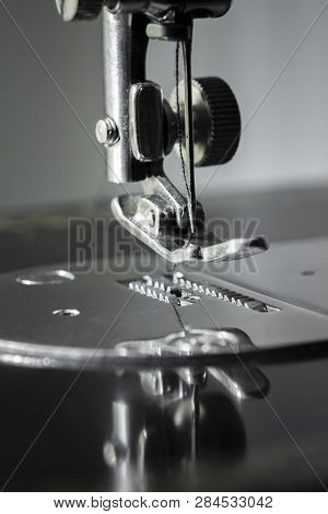 Sharp needle off sewing machine close up. poster
