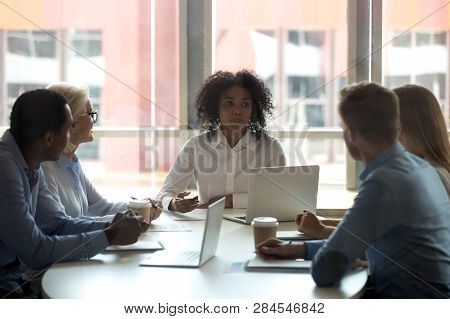 Five Diverse Business People Negotiating At Modern Boardroom