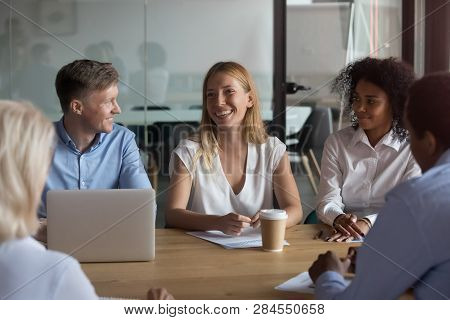 Different Business People Sitting Together In Boardroom Desk And Negotiating