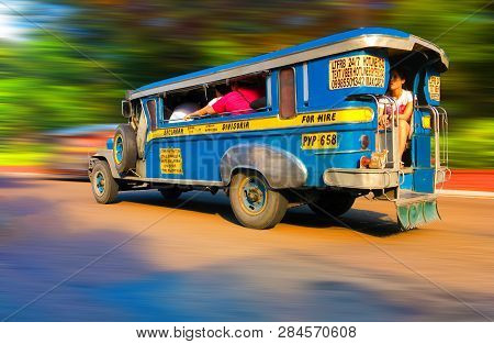 Manila, Philippines - September 24, 2018: Colorful Typical Bus Jeepney Overloaded With Passengers At