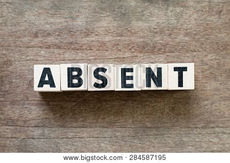 Letter Block In Word Absent On Wood Background