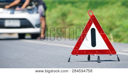Red Emergency Stop Sign And White Car After Accident On The Road