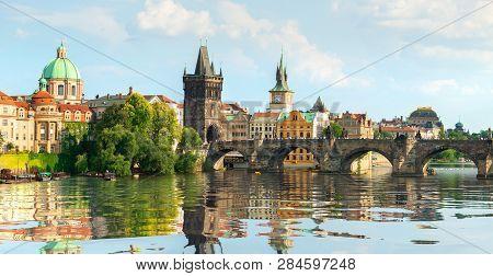 Famous Prague Charles Bridge On River Vltava At Sunset