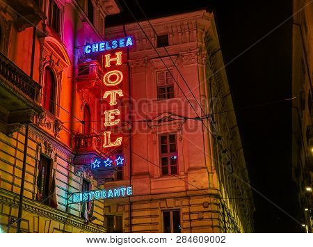 Turin, Italy - January 1, 2019. Hotel And Ristorante Neon Signboard In An Italian Street At Night. T
