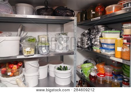 Different Foods, Fruits And Vegetables, Greens, Pre-cooked Dishes On Plates In Restaurant's Warehous