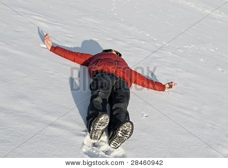 Man In A Bright Red Jacket Lying On The River-viable