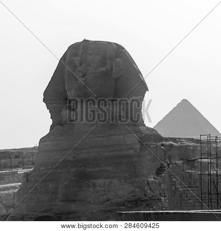 Giza, Egypt - April 13 2008: Sphinx And Pyramids (cheops And Khafre) In The Archeological Site Of Gi