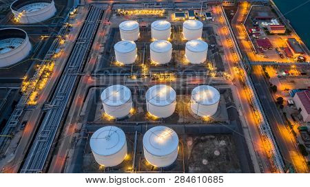 Oil Storage Tank, Gas Storage Tank At Night, Petrochemical Industrial, Aerial View Oil And Gas Stora