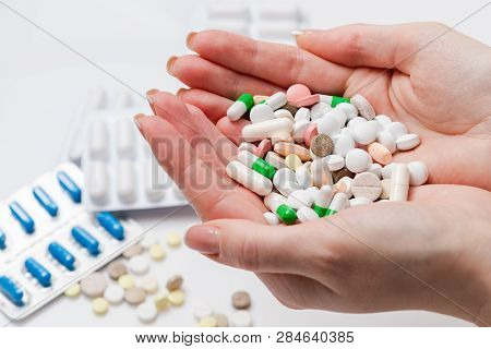 Photo Handful Full Of Pills And Capsules Of Different Colors. Top View. Colorful Medication And Pill