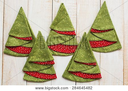 Patchwork And Quilting Concept - Closeup On Decorative Red-and-green Napkins On A Whitewashed Wooden
