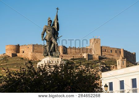 Medellin, Extremadura, Spain - February 13, 2019: The Statue Of Hernan Cortes With Castle Of Medelli