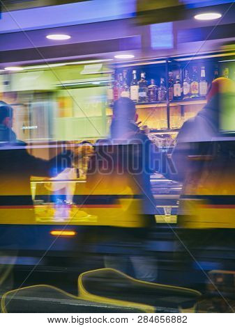 Milan, Italy - December 29, 2018. Citizens Drinking Coffee In A Bar Of Milan At Night. Lombardy, Ita