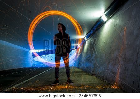 Long Exposure Of A Boy Swinging With Burning Steel Wool