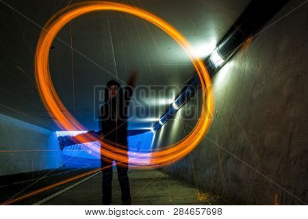 Long Exposure Shot Of A Boy Swinging With Burning Steel Wool