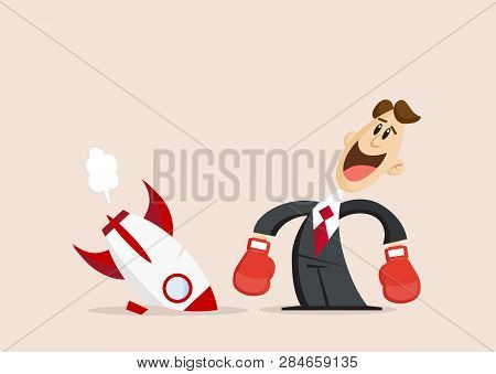 Happy Businessman With Boxing Gloves Stands Next To Broken Rocket