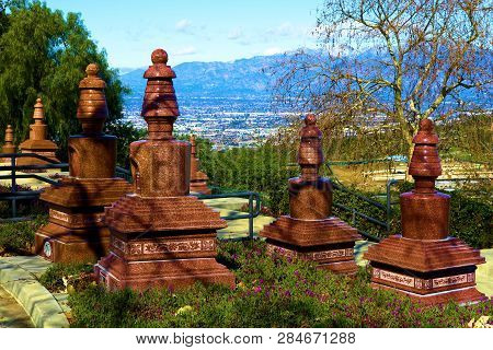 February 10, 2019 In Whittier, Ca:  Buddhist Headstones On Grave Sites At A Cemetery Surrounded By M
